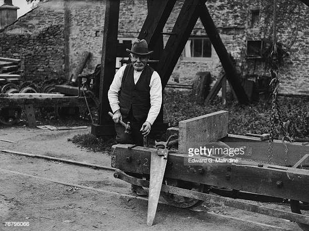 78yearold William Bowley builds a trolley for the Bath stone quarry in Corsham Wiltshire 24th October 1928