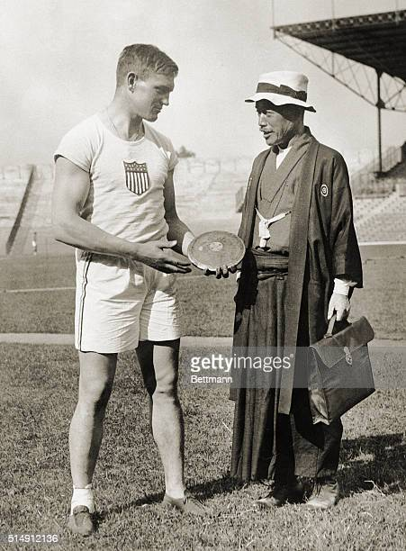 7/9/1924Paris France Paavo Nurmi of Finland poses with Fairbanks at the Paris Olympic Games Nurmi came through as expected outracing a fine field to...