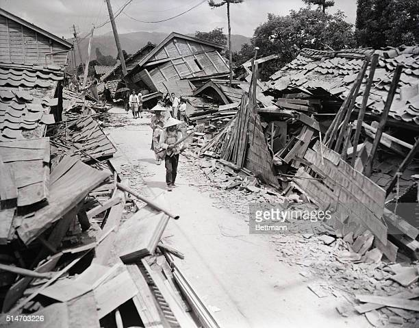 Fukui, Japan: Surrounded by destruction, many residents of Kanozu, North of Fukui, fled from their homes as the leading silk manufacturing city of...