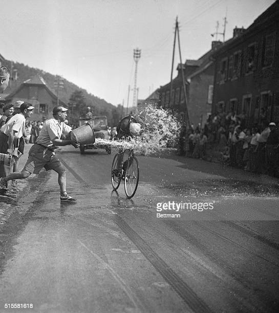 7/9/1952Bitschwiler France It Dosen't look like the most freindly thin in the world but it is The apparently unfriendly racing fan is actually a well...
