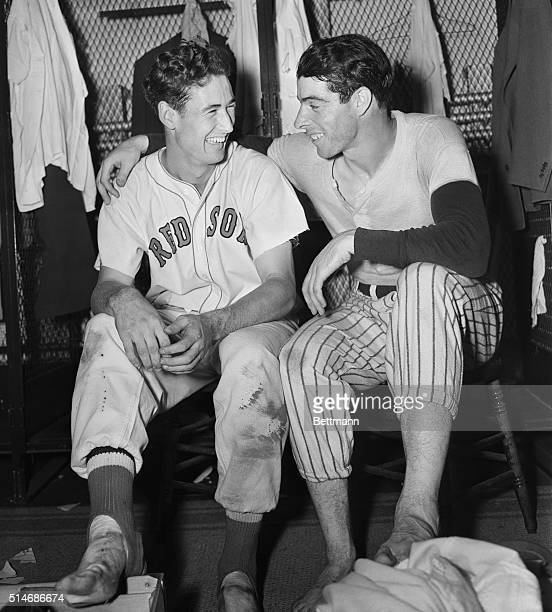 Detroit, Michigan: Ted Williams of the Boston Red Sox and Joe DiMaggio, Yankee stalwart, rest their feet after yesterday's hair-raising All-Star Game...