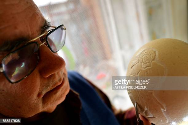 Year-old Hungarian folk artist, carver Laszlo Horvath prepares an Easter-gift, a carved ostrich egg, in his home in Kerepes, some 30 km east from...