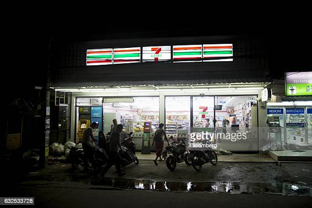 A 7Eleven convenience store operated by CP All Pcl stands illuminated at night in Koh Phangan Surat Thani Thailand on Tuesday Jan 17 2017 Government...