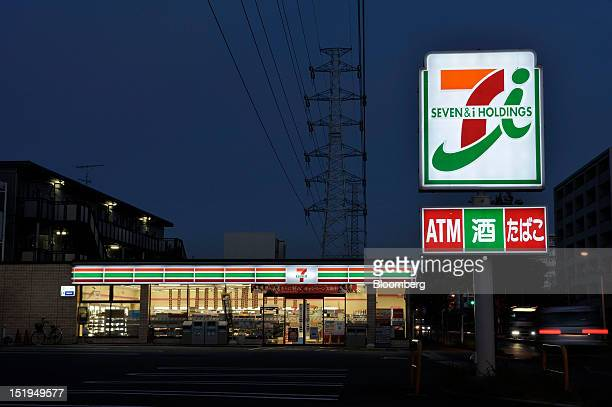 A 7Eleven convenience store operated by Seven I Holdings Co stands at night in Yokohama City Kanagawa Prefecture Japan on Tuesday Sept 11 2012 Sales...