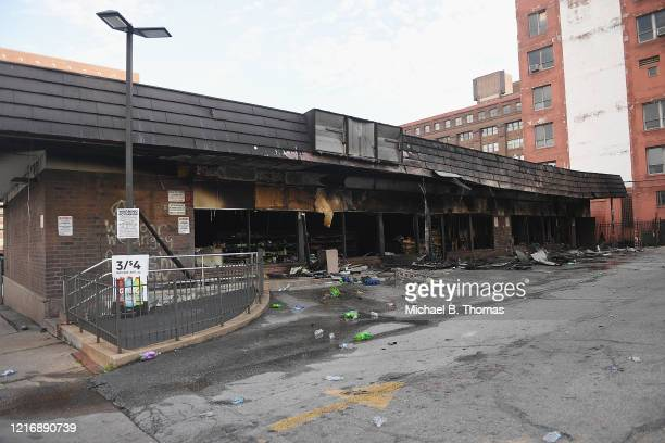 A 7Eleven is seen damaged after being set on fire during riots and looting overnight on June 2 2020 in St Louis Missouri Four police officers were...