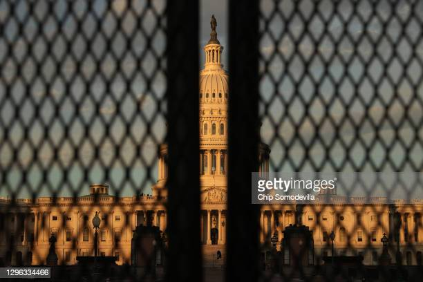 Foot tall 'non-scalable' fence surrounds the U.S. Capitol the day after the House of Representatives voted to impeach President Donald Trump for the...