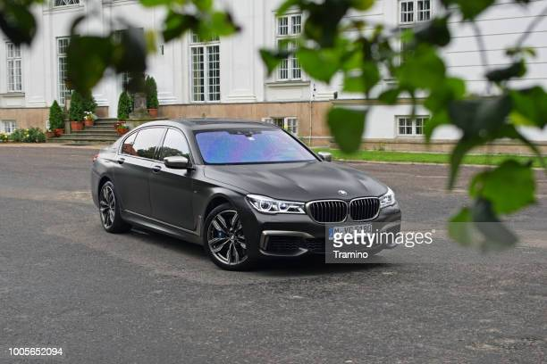 bmw 7-series on the street - bmw stock pictures, royalty-free photos & images