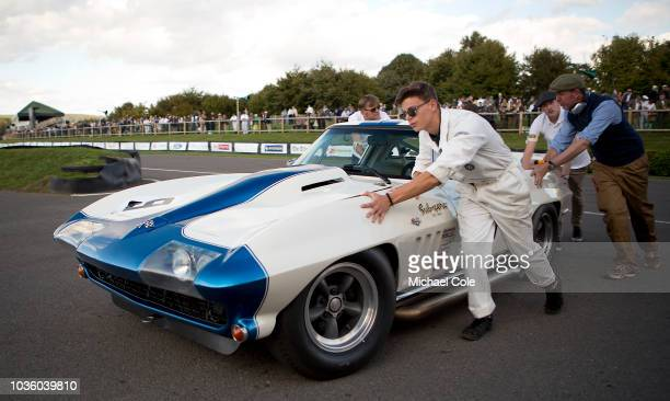 1965 Chevrolet Corvette Stingray driven by Craig Davies/Jason Plato being pushed off track after the RAC TT Celebration race during the 20th...