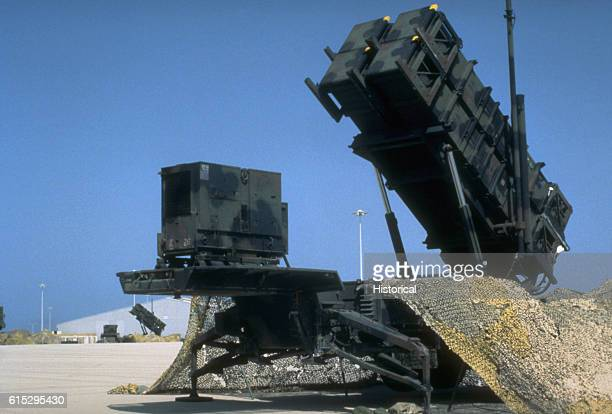 A 7th Air Defense Artillery Brigade Patriot tactical air defense system missile launcher deployed during Operation Desert Shield Another Patriot...