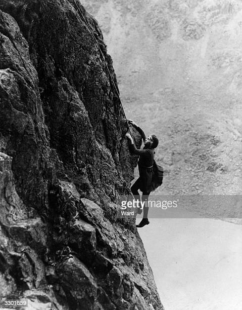 Untroubled by the height or a gale which is blowing 12yearold Irene Jackson of BarrowinFurness climbs the peak Dow Crag near Ambleside in Lakeland...