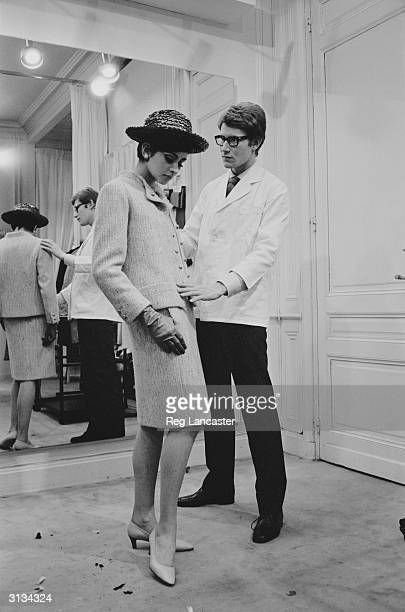 Yves Saint-Laurent, ex-wonder boy of Dior, working with a fashion model at his own fashion house in Paris.