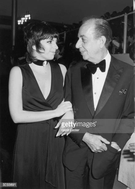 American actor and singer Liza Minnelli and her father, American film director Vincente Minnelli smile at each other at the Academy Awards, Dorothy...