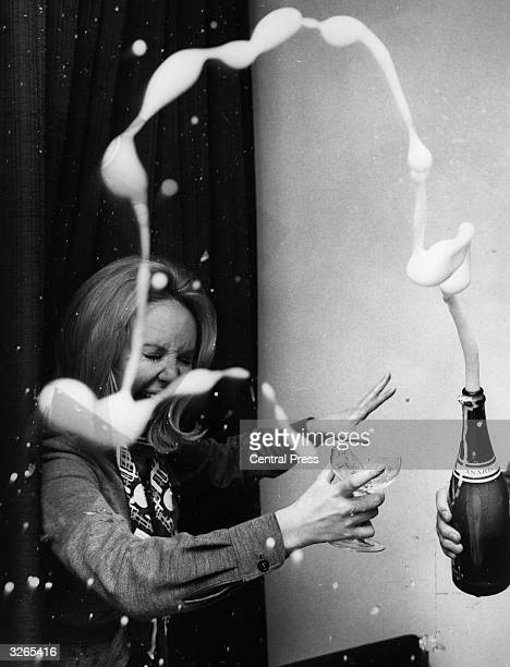 Glasgow born pop singer Lulu celebrates with champagne after hearing she will help host a TV show in America
