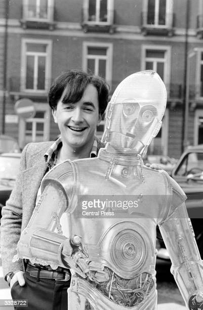 Actor Anthony Daniels witth C3PO the character he plays in the film 'star Wars'