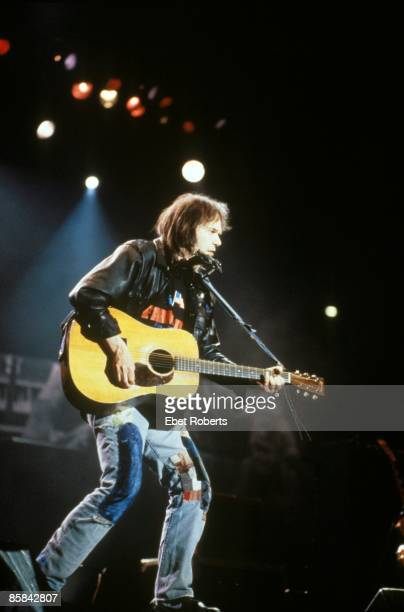 INDIANAPOLIS USA 7th APRIL Canadian singer/songwriter Neil Young performs live on stage at Farm Aid '90 at Hoosier Stadium in Indianapolis Indiana on...