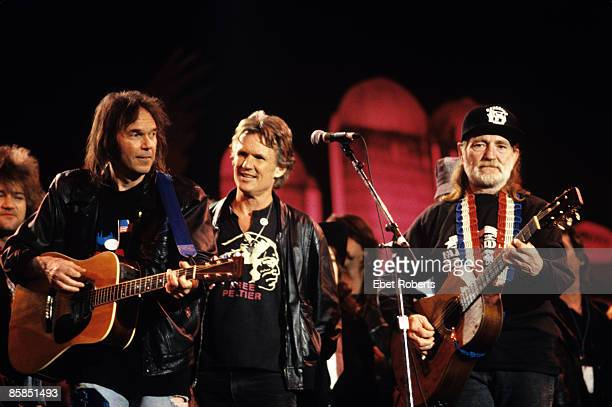 FARM AID Photo of Willie NELSON and Neil YOUNG and Kris KRISTOFFERSON LR Neil Young Kris Kristofferson and Willie Nelson performing on stage at Farm...