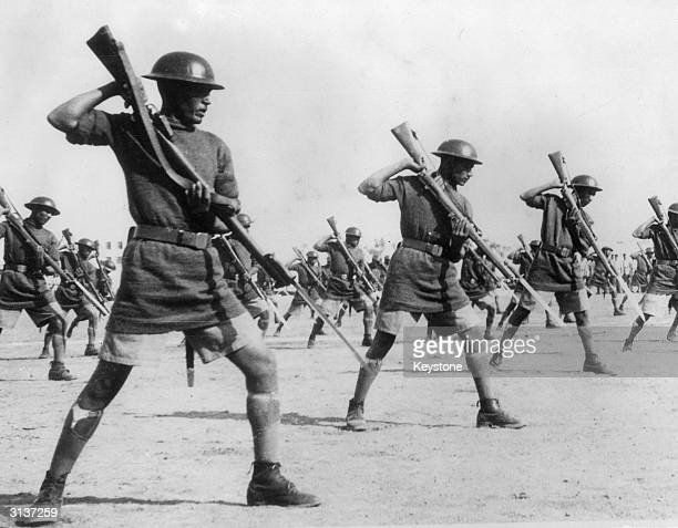 Egyptian troops on bayonet drill in their barracks in preparation for an attack by Italy