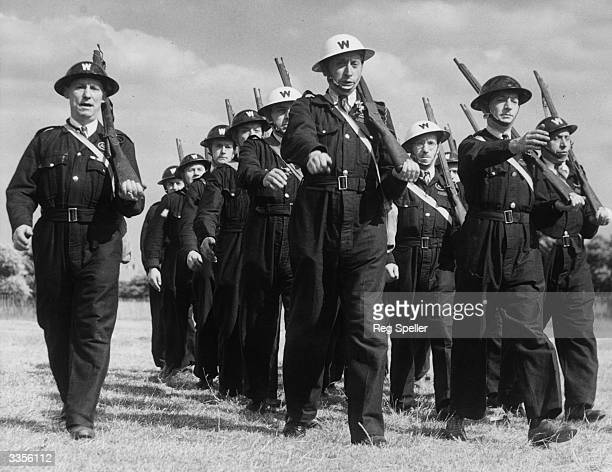 Hackney air raid wardens on the march during training The rifles they are carrying are dummy ones used to give a smart effect