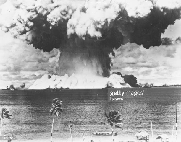 A mushroom cloud rises from the waters of Bikini Lagoon during the United States first series of underwater atomic tests Ships of a 'Guinea Pig'...
