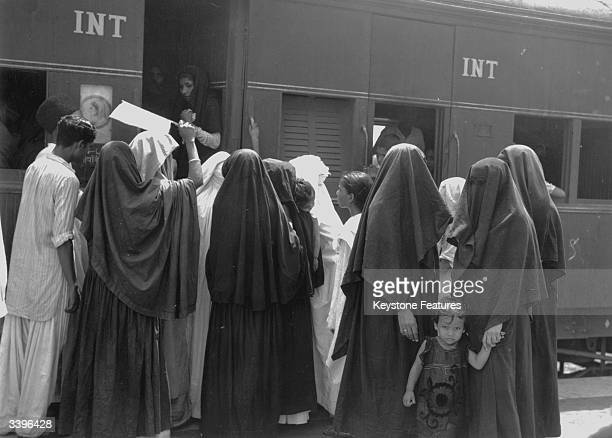 Muslim women boarding a train at New Delhi in India to travel to the newly independent Pakistan