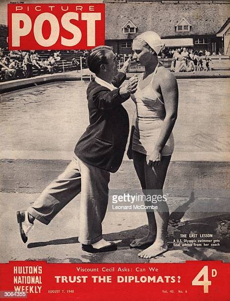 An American Olympic swimmer receives a lastminute piece of advice from her coach at the Wembley pool London The headline beneath reads 'Viscount...