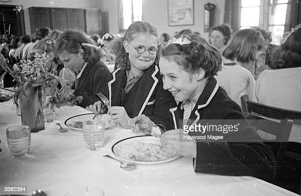 Pupils from Wakefield enjoying a meal together at the residential branch of their school by the seaside in Hornsea which provides a change of scene...