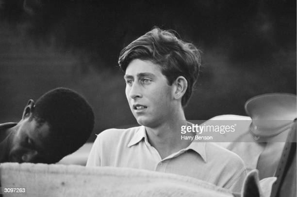 Prince Charles standing behind a horse during a polo match in Jamaica