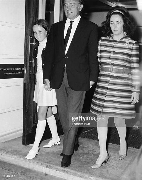 Actress Elizabeth Taylor leaves the Fitzroy Nuffield Nursing Home in London after a partial hysterectomy Accompanying her are her husband Richard...
