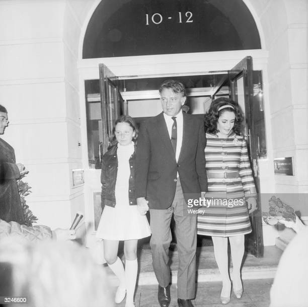 Actress Elizabeth Taylor leaves the Fitzroy Nuffield Nursing Home in London after a partial hysterectomy operation Accompanying her are her husband...