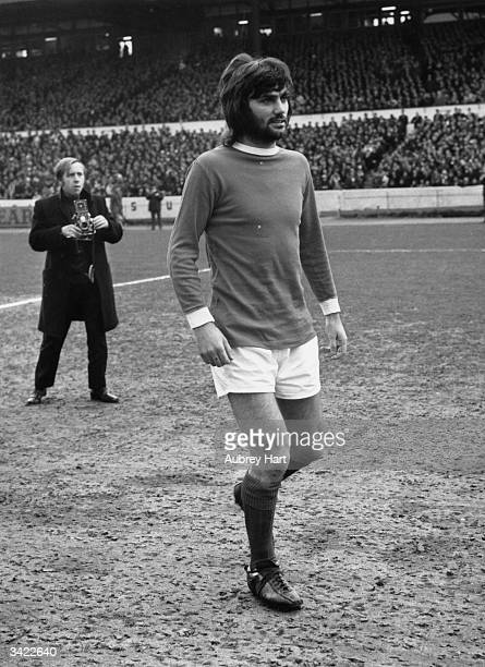 George Best of Manchester United and Northern Ireland on the pitch before the start of the match