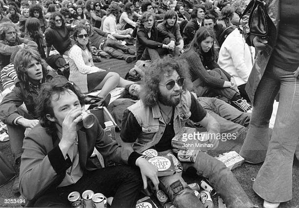 Fans during an interval in the Isle of Wight pop festival