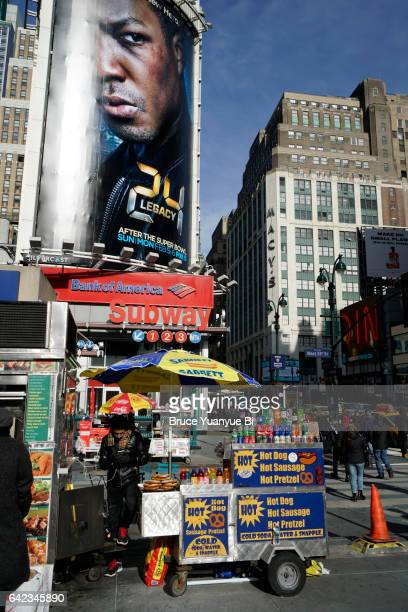 7th Avenue in midtown of Manhattan covered with advertising billboards