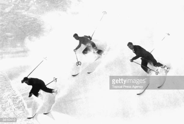 Three skiers in action on the slopes at Engelberg Switzerland