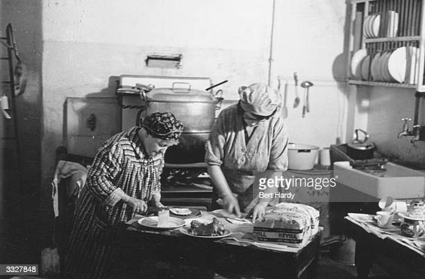Mrs Davie and her sister Nurse Conway founders of the London Husbands' Hostel make the sandwiches for the residents' lunch The hostel takes in men...