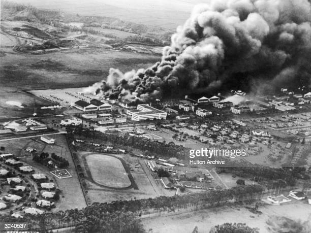 Aerial view of the US Hawaiian Air Base at Wheeler Airfield burning after the Japanese attack on Pearl Harbor Honolulu Hawaii Photograph taken by a...
