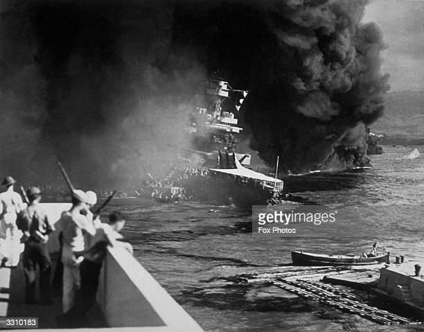 The USS California on fire in Pearl Harbour after the Japanese attack