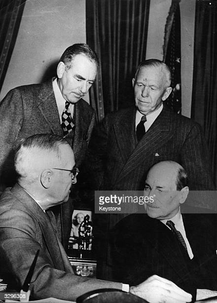 Talking at the White House in Washington DC are the 33rd President of the United States of America Harry S Truman and the British Prime Minister...