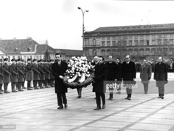 German Federal Chancellor Willy Brandt laying a wreath at the Unknown Warriors Tomb in Warsaw with Walter Scheel and Egon Emmel