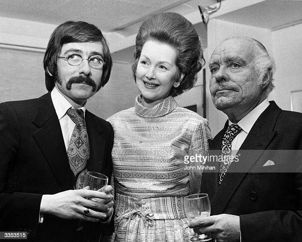 From left to right Dr Roy Strong director of the National Portrait Gallery Countess Dartmouth later Raine Spencer and cartoonist Osbert Lancaster at...