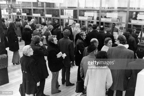 Motorists queue at the Post Office in Trafalgar Square London to collect their petrol coupons during the petrol shortage crisis of 1973