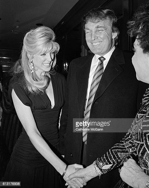 Donald Trump and Marla Maples pose for a photo at comedian Joey Adams' 80th birthday party on January 7 1991 in New York City New York