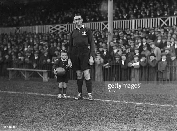 Wales V Scotland at Swansea Steve Morris Welsh Captain with mascot Dan Jones holding a Rugby Ball