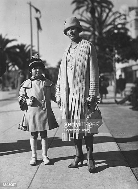 A fashionably dressed mother and daughter on a Paris suburb's street