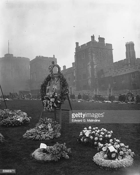 Floral tributes to the late King George VI lie near St George's Chapel at Windsor Castle.