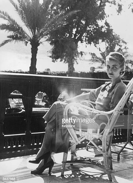 American socialite and Woolworth heiress Barbara Hutton the Countess von HaugwitzReventlow relaxes on the balcony of the Mena House Hotel in Cairo...