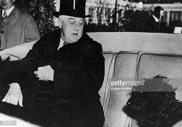 American President Franklin Delano Roosevelt in his car with his Scottish terrier, Mr Falla.
