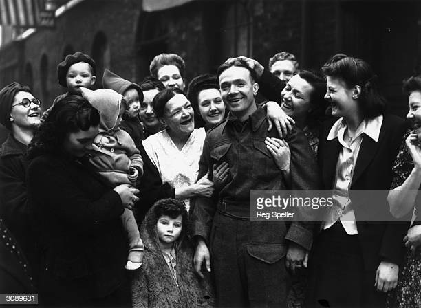 Private Fred Poulten arrives home in Clerkenwell to a hero's welcome by his mother and friends He has been repatriated after being taken prisoner at...