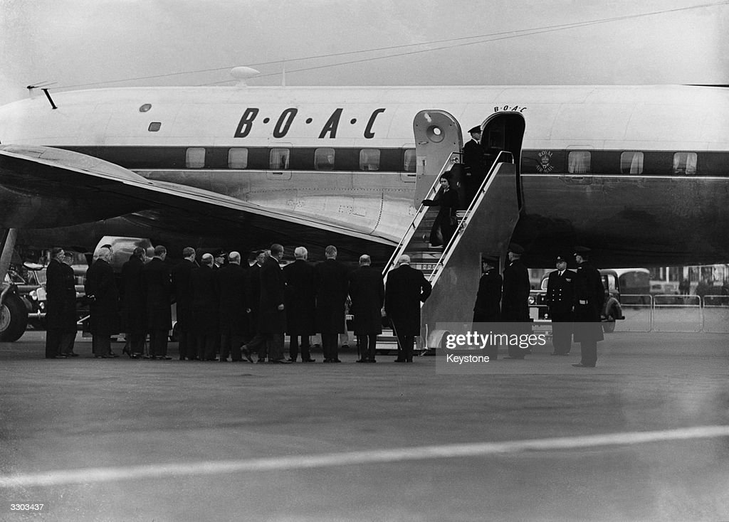 Princess Elizabeth is greeted by Winston Churchill on her return from Africa following the death of her father George VI.