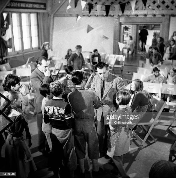 Some of the residents of the Swiss village of Pestalozzi on set during production of the film 'The Village' by the Swiss Praesena Film company...