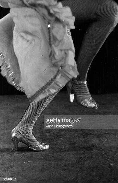 The legs of flamenco dancer Vadja delOro, who is performing in 'Wonderful Time' at the London Hippodrome. Original Publication: Picture Post - 6414 -...